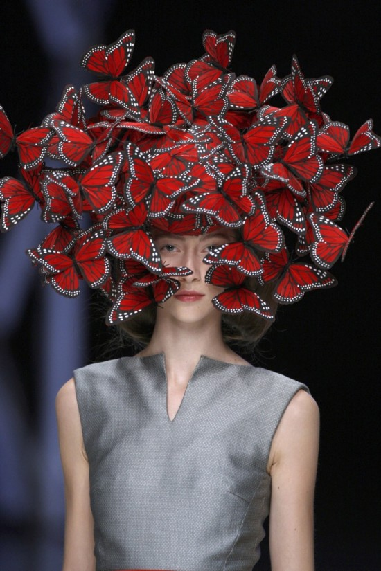 Butterfly headdress of hand-painted turkey feathers by Philip Treacy  for Alexander McQueen